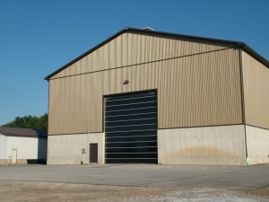 image of commercial building with poly garage doors